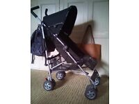 Mothercare Nanu pushchair stroller wih raincover. Black grey and yellow.