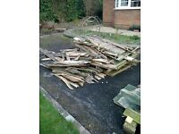 Two fairly large wood piles for burning in a woodburner