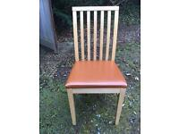 Solid wood dining chairs with tan leather effect seats
