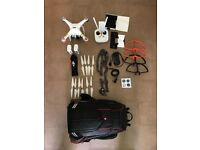DJI Phantom 3 Pro, two batteries, many sets of props, prop guards, Manfrotto backpack.