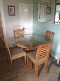 Solid oak kitchen table, with glass top and 4 chairs