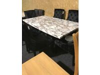 6ft NEW Marble table +six BRAND NEW CHNOKERBACK BLACK CHAIRS