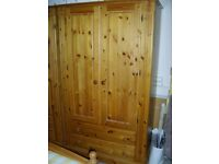 Solid Pine Double Wardrobe, with 2 full width drawers.
