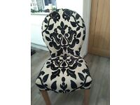 Six patterned dining chairs,