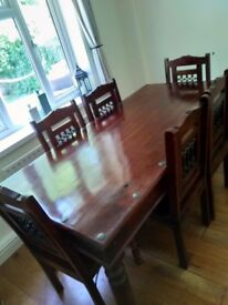 Dark solid wood dining table and 6 chairs