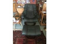 Green leather swivel recliner chair and foot stool