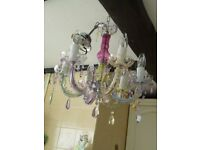 Lovely pastel shades candelabra ceiling light. Glass effect