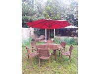 Garden table, 6 arm chairs & parasol