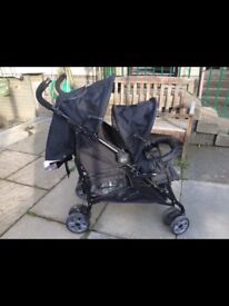 Double buggy with raincover excellent condition
