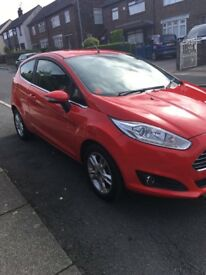 Red Ford Fiesta 2015 plate.