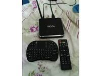 MXq Android smart tv box kodi and madbro installed ready to stream