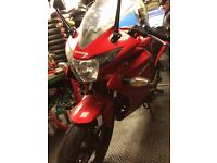 Honda CBR125R Red 2014 I purchased this bike CAT D repaired