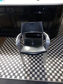 4 OUTDOOR STACKABLE BLACK AND CHROME ARMCHAIRS