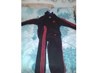 Red & black Adidas hoodie and bottoms