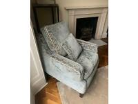 Two beautiful patterned teal coloured armchairs