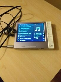 Brand New Archos 405 media player and Beats in ear headphones.