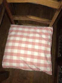 Pink and white chequered cushion