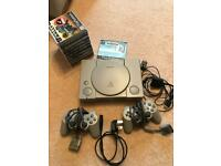 PlayStation 1 Dual Shock with tri format steering wheel boxed with 8 games and 2 controllers