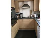 Kitchen with integral oven and fridge/freezer, dishwasher, washing machine, gas hob and cooker hood