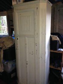 Tall single wooden wardrobe