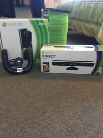 XBOX 360 Slim 250 GB with 2 Wireless Controllers, 25 games, a KINECT sensor and a Steering Wheel