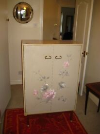 1960s vintage wardrobes - grey with pink & grey floral design. All wood interior on brass legs.