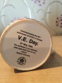 Collectible V E day celebration mugs