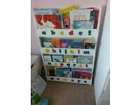 White wooden alphabet storage bookcase