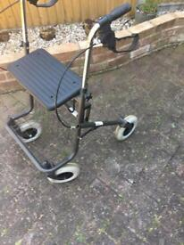 Walking aid with 4 wheels and seat