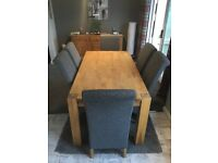 Heavy duty pine dinning room table and 6 high back chairs.