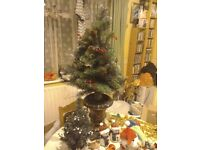 Job lot of Christmas deorations , all used before except the tree which is unused .