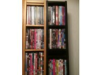 Job lot of approximately 150 DVDS & 140 CDs and shelves