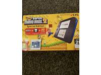 2ds with mario (on console) and batman (cart)