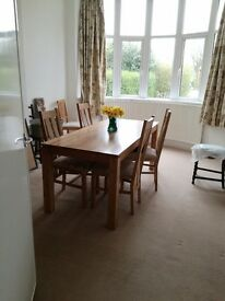 Oak dinning table with chairs