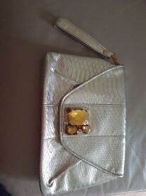 New without tag Star by Julian Macdonald clutch bag, kind of silver/gold colour with jewels