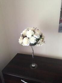 Champagne flutes with floral arrangement centrepiece table decor