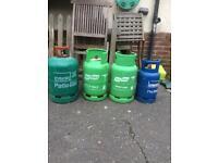 4 Empty patio gas bottles 2 11kg,1 13kg and 1 butane 7kg