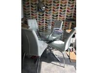 Glass dining table & 4 white chairs