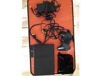 PlayStation 2 with 50 games.