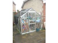 Used greenhouse 8ft X 6ft sliding door and with metal base No broken glass