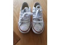 White leather converse size 11.