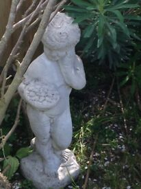 Gorgeous statue of little boy holding bowl