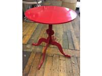 Red round side table