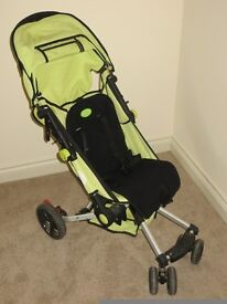 Stroller with rain cover and footmuff