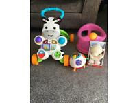 4 baby items. Fisher price zebra walker pink bath seat v-tech learn and crawl and a grow play teddy