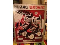 Kids adjustable quad skates/boots. Worn once! Like new! Size 11-13