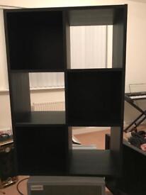 Black cube storage unit