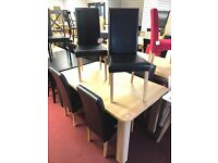 Extendable Tabe oak effect and 6 Black leather chairs