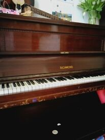 A pre-loved upright piano