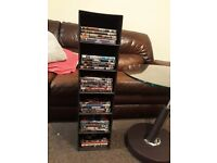 Brown leather dvd stand/case with 32 dvds